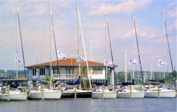 View of a marina with sailboats and boat house