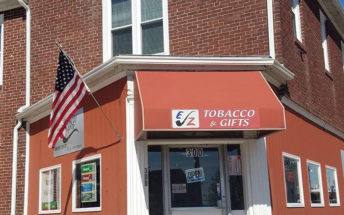 Orange tobacco shop storefront.