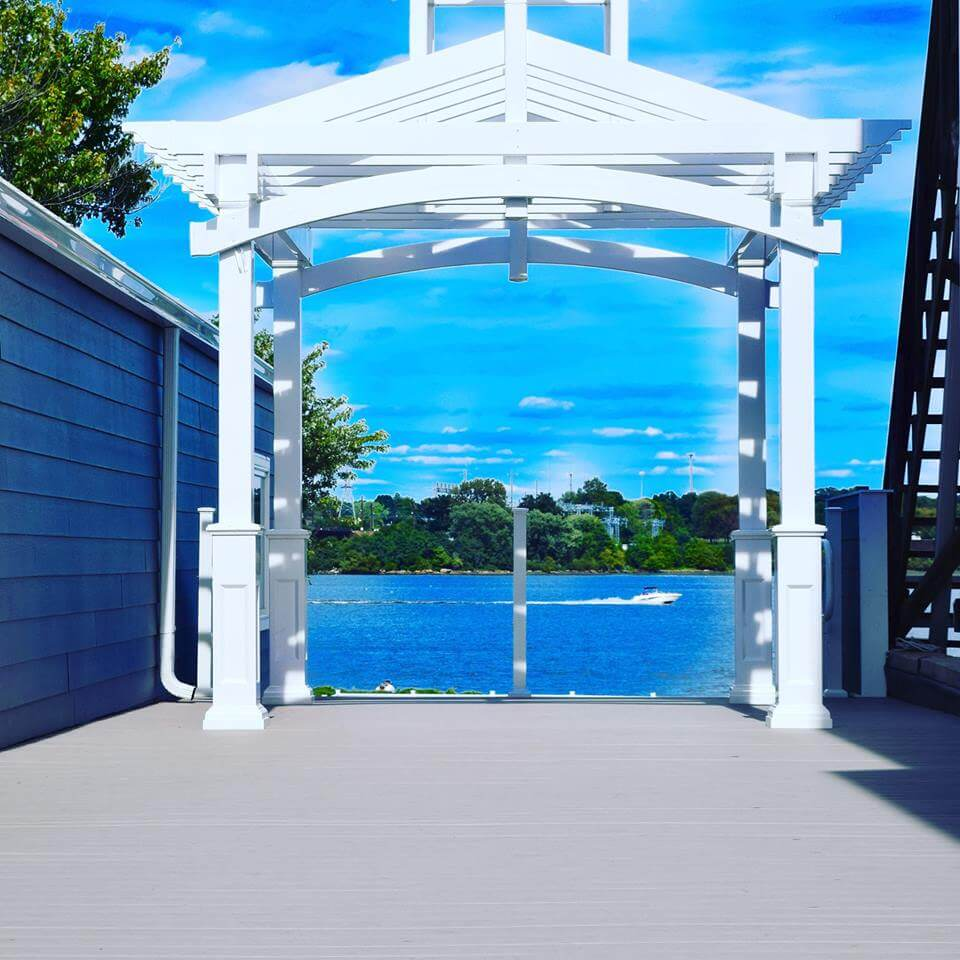 White waterfront pergola