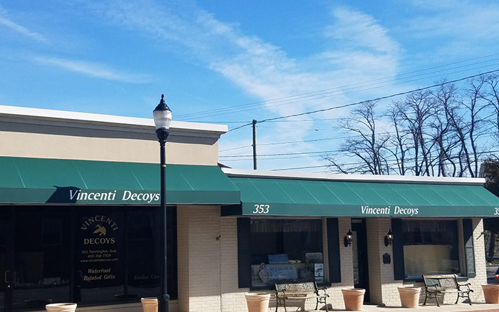 Vincentis Decoy storefront with green awning.