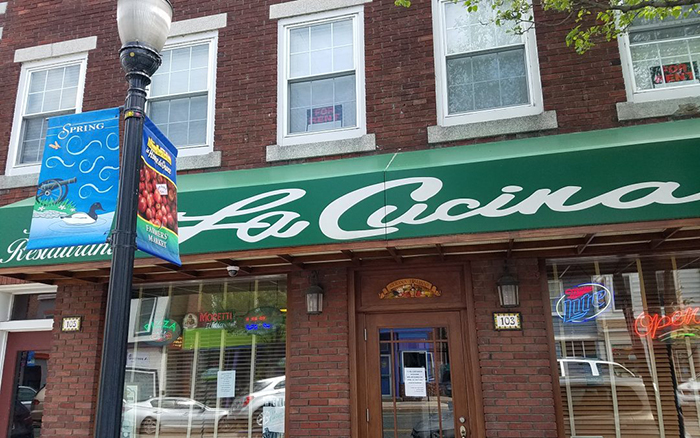 Italian restaurant brick front with green awning.