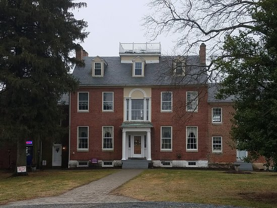 Three Story colonial style brick house